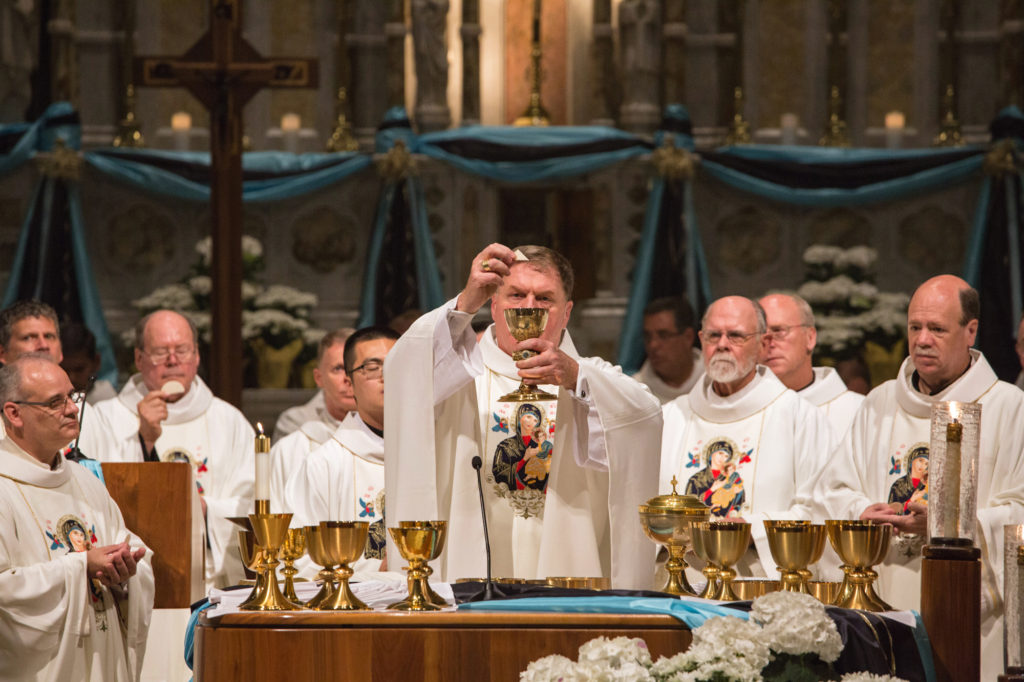"(6-27-2016) Most Reverend Joseph W. Tobin, C.Ss.R., Archbishop of Indianapolis, lifted the chalice and host during the Mass celebrating 150 years of the Mother of Perpetual Help Devotion at St. Alphonsus ""Rock"" Church in midtown St. Louis on June 27, 2016."